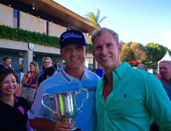 Travis celebrates with 2015 Emirates Australian Open Champion, Matt Jones